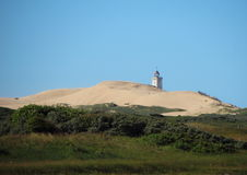 Lighthouse at Rubjerg Knude with Sand dune and Blue Sky Royalty Free Stock Photography