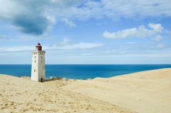 Lighthouse Rubjerg Knude and sand dunes at the danish North Sea Stock Image