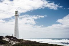 Lighthouse on a rugged coastline with a vintage look. In Cape Town South Africa Royalty Free Stock Photography