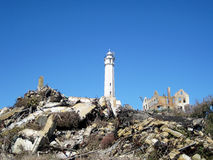 Lighthouse and ruins on Alcatraz island (California, USA). San Francisco, USA - October 22, 2008: Lighthouse and old ruins of Alcatraz prison on Alcatraz island Stock Photography