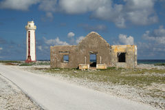 Lighthouse and Ruins of Keeper's House - Bonaire. Historic Lacre Point Lighthouse and Ruins of Old Lightkeeper's House - Willems Toren, Bonaire, Netherlands Stock Image