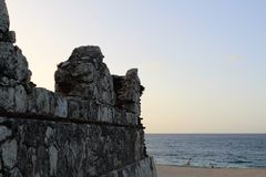 Lighthouse ruins always watching, always ready in front of the sea at Aguadilla, Puerto Rico Royalty Free Stock Image