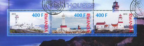 Lighthouse. RWANDA - CIRCA 2012: stamp printed by Rwanda, shows Lighthouse, circa 2012 Royalty Free Stock Photography