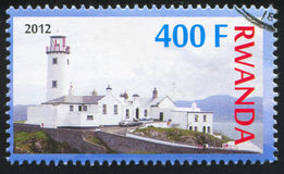 Lighthouse. RWANDA - CIRCA 2012: stamp printed by Rwanda, shows Lighthouse, circa 2012 Stock Photography