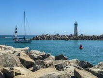 Lighthouse and sail boats Royalty Free Stock Photos