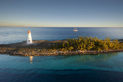Lighthouse and sail ship at the tip of Paradise Island in Nassau, Bahamas Royalty Free Stock Images