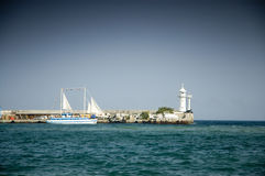 Lighthouse and sailboat Royalty Free Stock Photo
