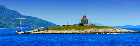 Lighthouse and sailing boat 2 Royalty Free Stock Images