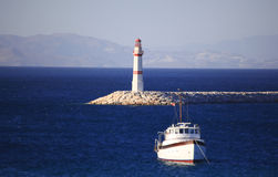 Lighthouse and sailing Boat Royalty Free Stock Photography