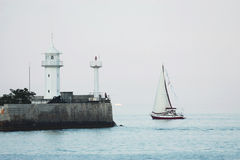 Lighthouse and sailor Stock Images