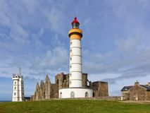 Lighthouse of Saint-Mathieu with ruins of abbey and semaphore to Royalty Free Stock Photography
