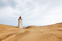 Lighthouse and sand dune Royalty Free Stock Photos