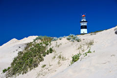 Lighthouse on sand dune Stock Images