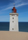 Lighthouse with Sand Dune and Blue Ocean in Horizon Royalty Free Stock Photos