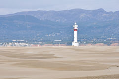 Lighthouse and sand dunes in Punta del Fangar (Spain) Royalty Free Stock Images