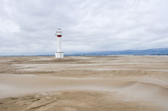 Lighthouse and sand dunes in Punta del Fangar (Spain) Stock Image