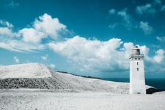 Lighthouse and sand dunes by the sea. Lighthouse, sand dunes by the sea Royalty Free Stock Images