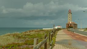 Lighthouse at Sao Pedro de Moel in Portugal stock footage
