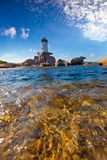 Lighthouse from the sea. Stock Photo