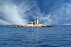Lighthouse in the sea Stock Photos