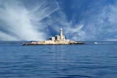 Lighthouse in the sea Stock Photos