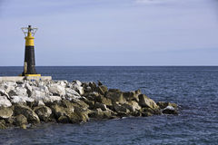 Lighthouse on the sea Stock Images