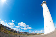 Lighthouse with the sea in the background Stock Photography