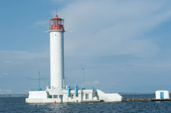 Lighthouse in the sea. Beacon for ships at sea Royalty Free Stock Photo