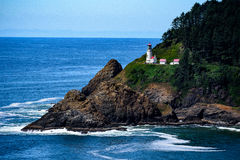 Lighthouse on sea cliff Royalty Free Stock Image