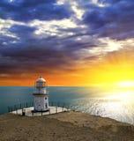 Lighthouse on a sea coast Stock Photos