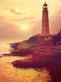 Lighthouse at sea coastline. Sunset on beach. Tined toned colora Royalty Free Stock Images