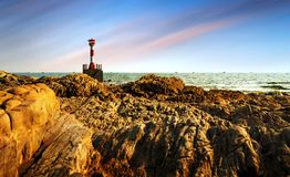 Lighthouse by the sea Royalty Free Stock Images