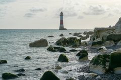 16/09/2018 Eastbourne, United Kingdom. Beachy Head Lighthouse. Lighthouse in the sea with only one access only while tide off stock photography