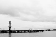 Lighthouse and sea port landscape. In black and white Stock Photography