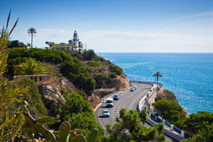 Lighthouse, sea and road near Calella, Spain Stock Image