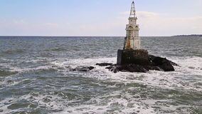 Lighthouse in sea stock video footage