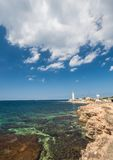 Lighthouse, sea and rock, blue sky Royalty Free Stock Photo