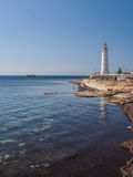 Lighthouse, sea and rock, blue sky. Crimea. Ukraine royalty free stock photo