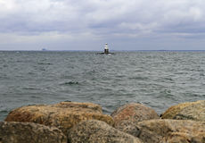 Lighthouse at sea shore in Malme. Sweden Stock Image