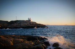 Lighthouse by the sea Stock Photography