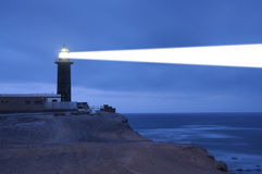 Lighthouse searchlight beam through foggy air royalty free stock photo