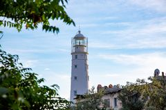 Lighthouse searchlight beam near ocean at day light Lighthouse in clear weather.  royalty free stock photos