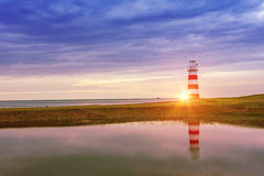 Lighthouse seascape sunset and twilight Royalty Free Stock Images