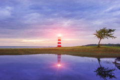 Lighthouse seascape sunset and twilight Royalty Free Stock Photography