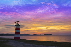 Lighthouse seascape sunset and twilight Stock Photo