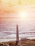 Lighthouse on seashore Royalty Free Stock Photography