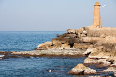 Lighthouse on a seashore in summertime Royalty Free Stock Photo