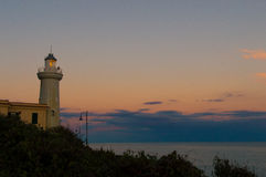 Lighthouse in seen at dusk with cloody peaceful sky Stock Photography