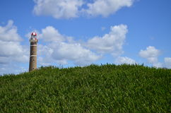 Lighthouse. A lighthouse seen by the field Royalty Free Stock Photo