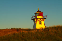 Lighthouse in Setting Sun Stock Photography
